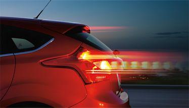 The 2014 Focus Titanium Hatchback Shown In Ruby Red Metallic