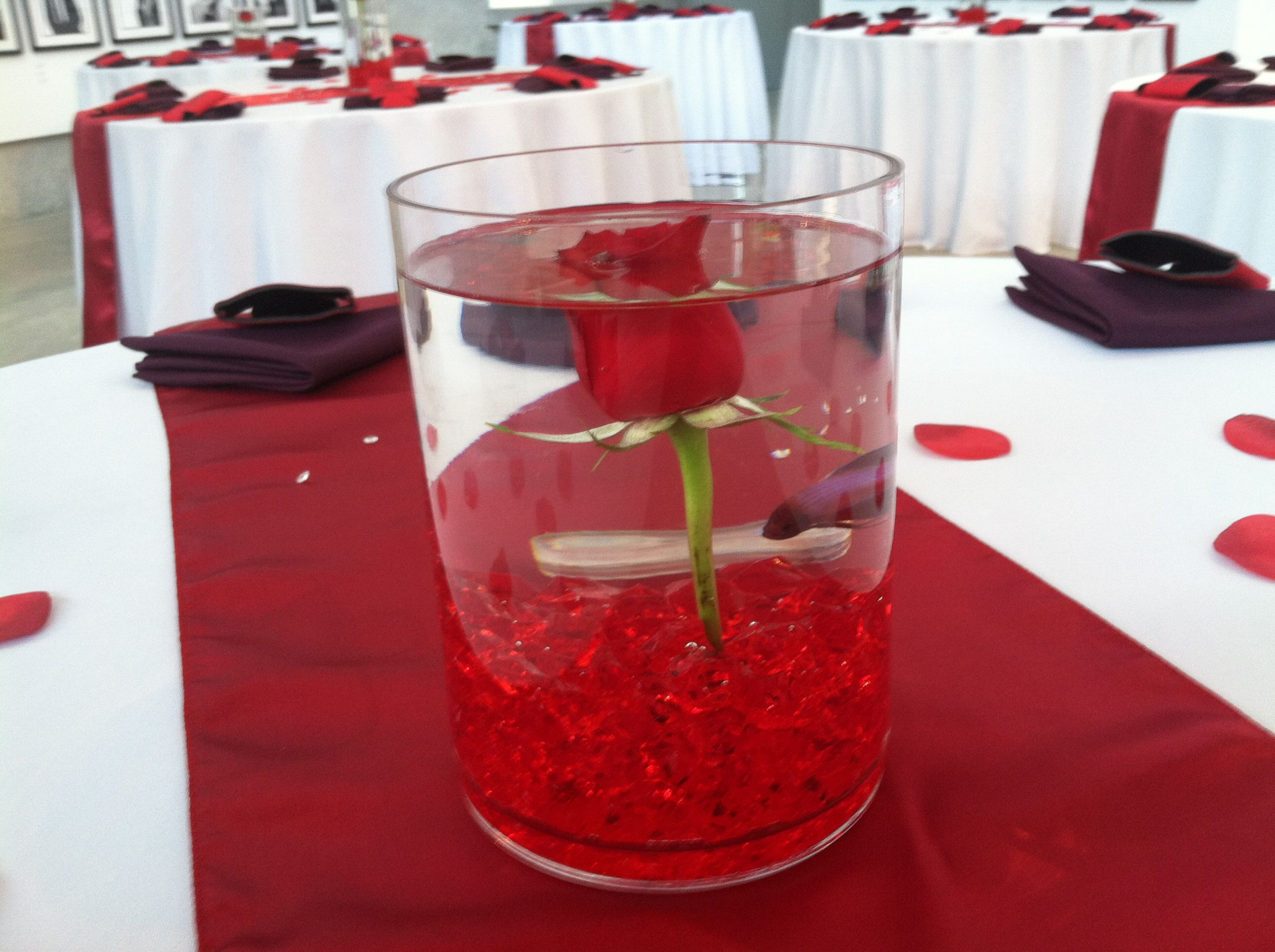 Cylinder vase with red acrylic rocks, red fresh rose, white ...