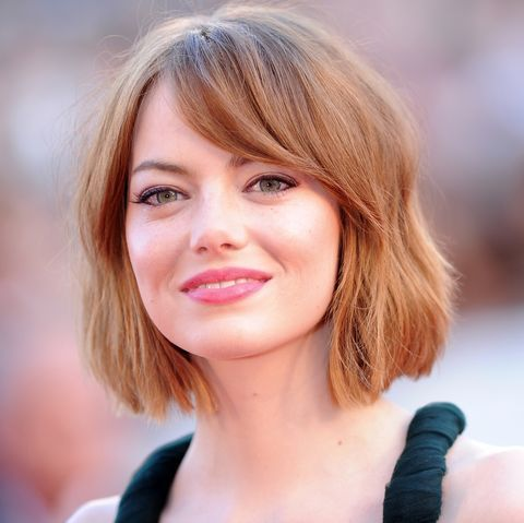 How To Style Side Swept Bangs Like 30 Of The Chicest Celebrities Emma Stone Hair Color Emma