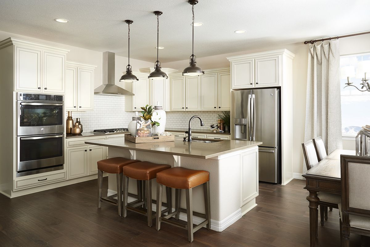 Kitchen Model Homes warm, inviting white kitchen in aurora, colorado. | arlington