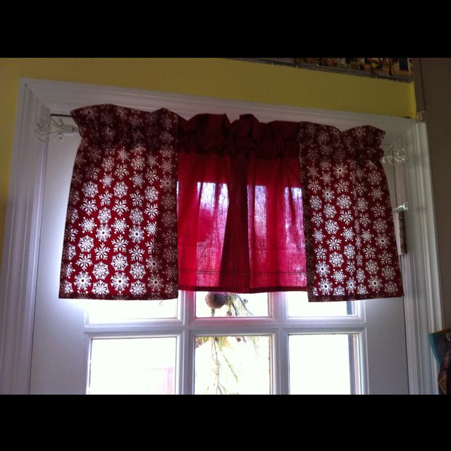 Window/door valance made with hand towels and curtain rod.