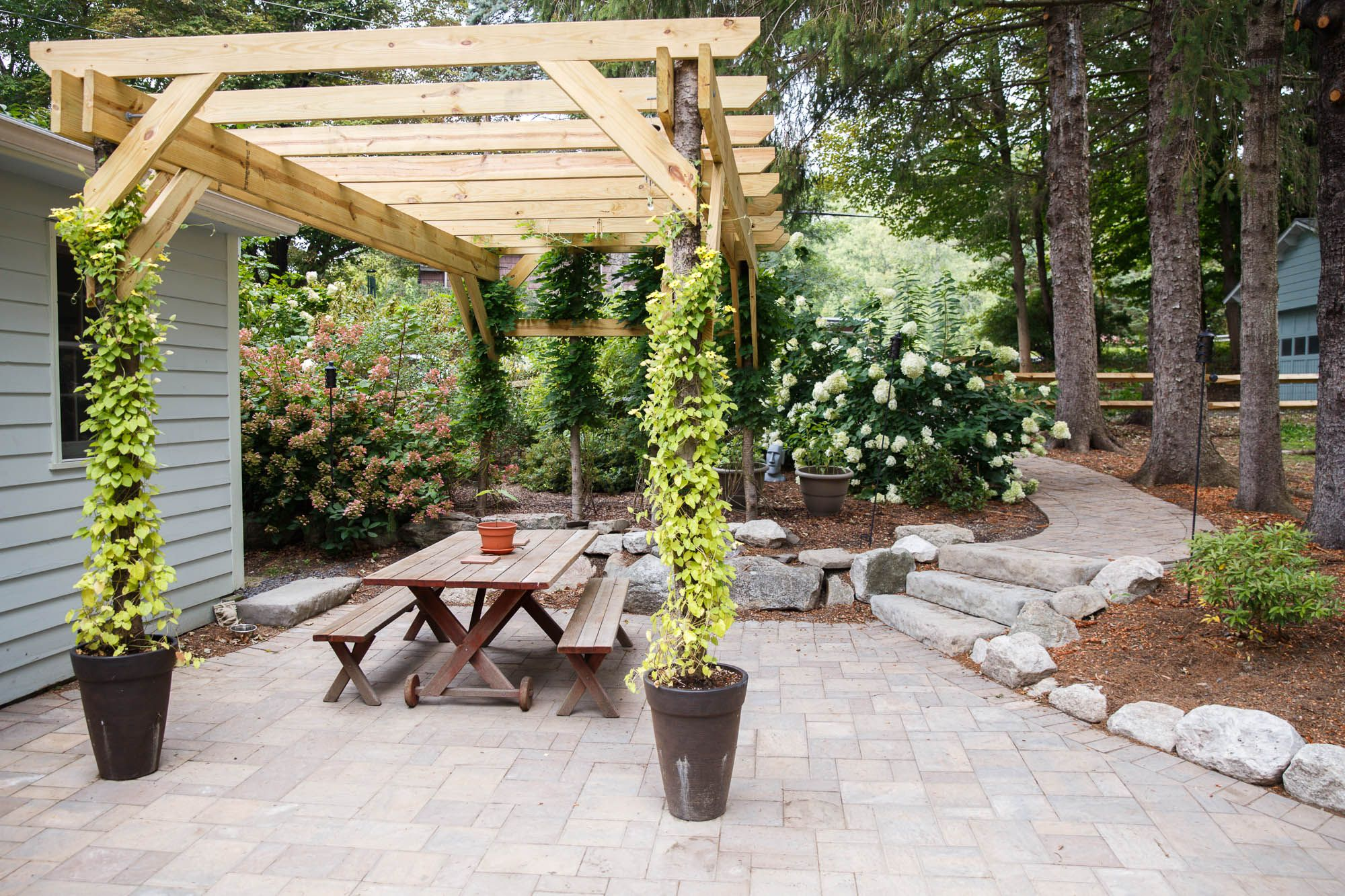 a patio a pergola and a rustic path to get you there outdoor