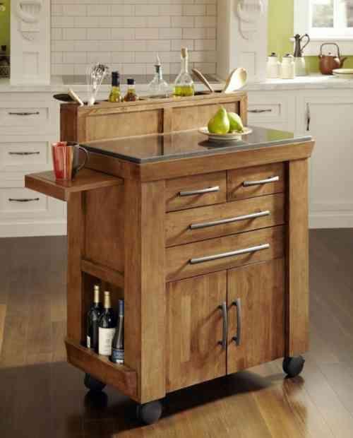Meuble De Rangement Dan La Petite Cuisine Ilot A Roulettes Kitchen Island Storage Portable Kitchen Island Kitchen Cart