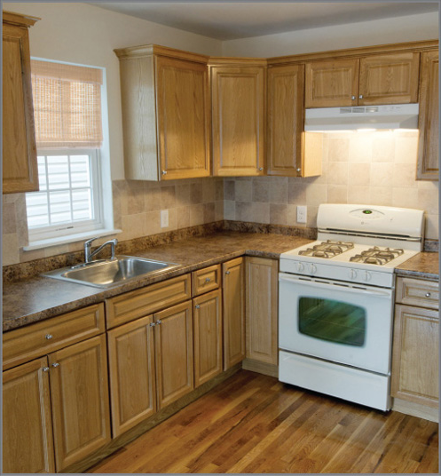Color example of light oak cabinets with light med granite for Brown kitchen cabinets with black appliances
