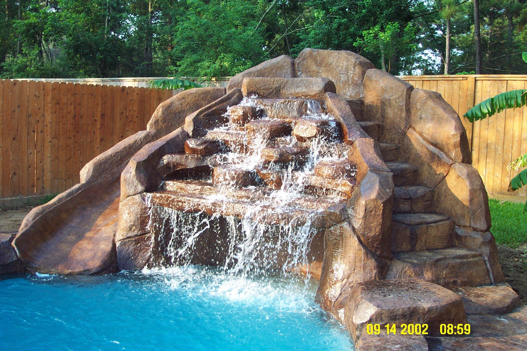 Pool waterfall and slide pools pinterest pool for Pictures of backyard waterfalls