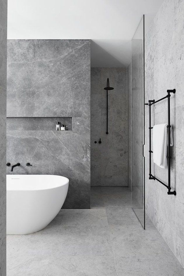 10 Stunning Stone Tile Bathroom Designs That Made Our Editors Do A Double Take Hunker Grey Bathrooms Designs Modern Bathroom Design Bathroom Interior Design