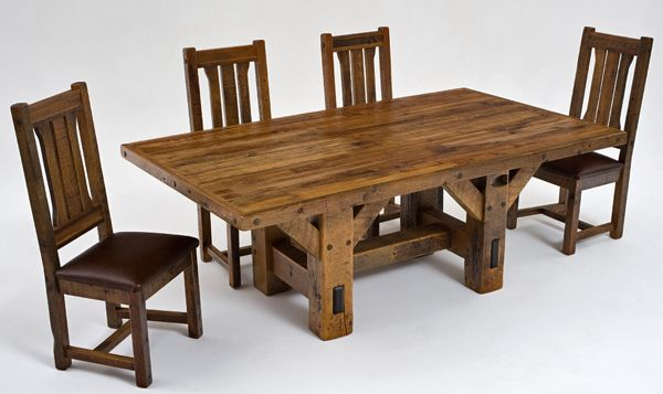 This barnwood dining table is hand made from thick solid wooden salvaged  beams and old wood