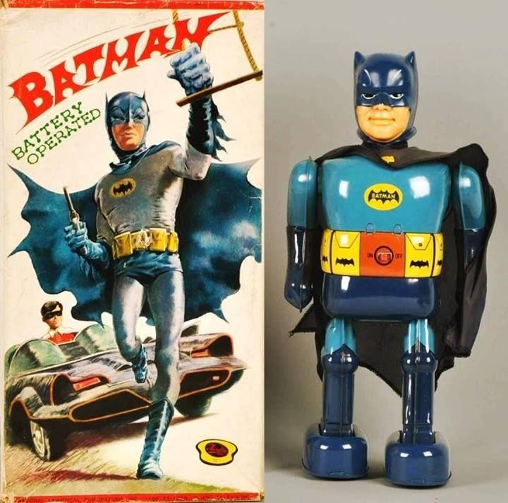 1966 battery-operated walking Batman toy. Tin with vinyl head.