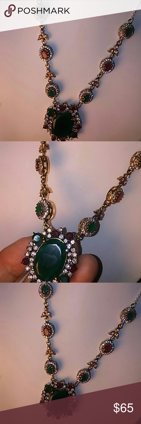 Firm PriceTurkish high quality elegant necklace. This necklace is unique ,925 sterling silver and bronze. Has 4 Emerald stone 2 ruby stone.has pendant w.big Emerald stone ruby,and emerald and clear topaz.Mark 925.Beautiful. Piece.new no tag.long 20 inch.The emerald stone in the pendant long1 inch.color green,red,clear stone,and silver. Jewelry Necklaces