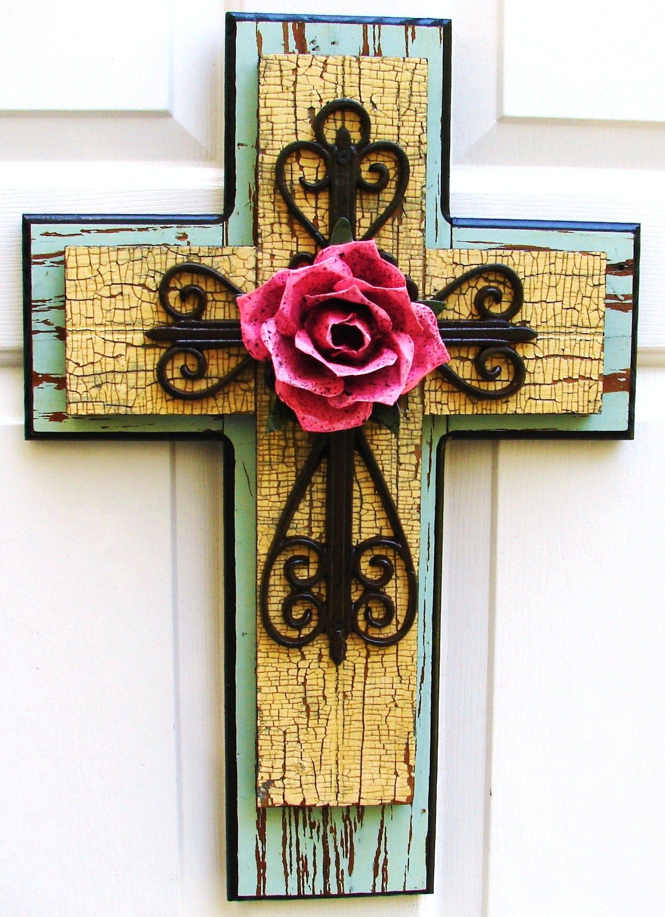 Rustic green/yellow stacked wooden cross with brown iron cross and pink metal rose.  $85.00