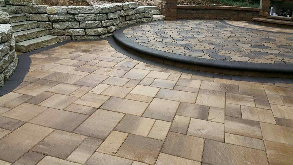 Belgard Lafitt Patio Slab With A Charcoal Bullnose Step Up To A Mega Arbel  Patio.