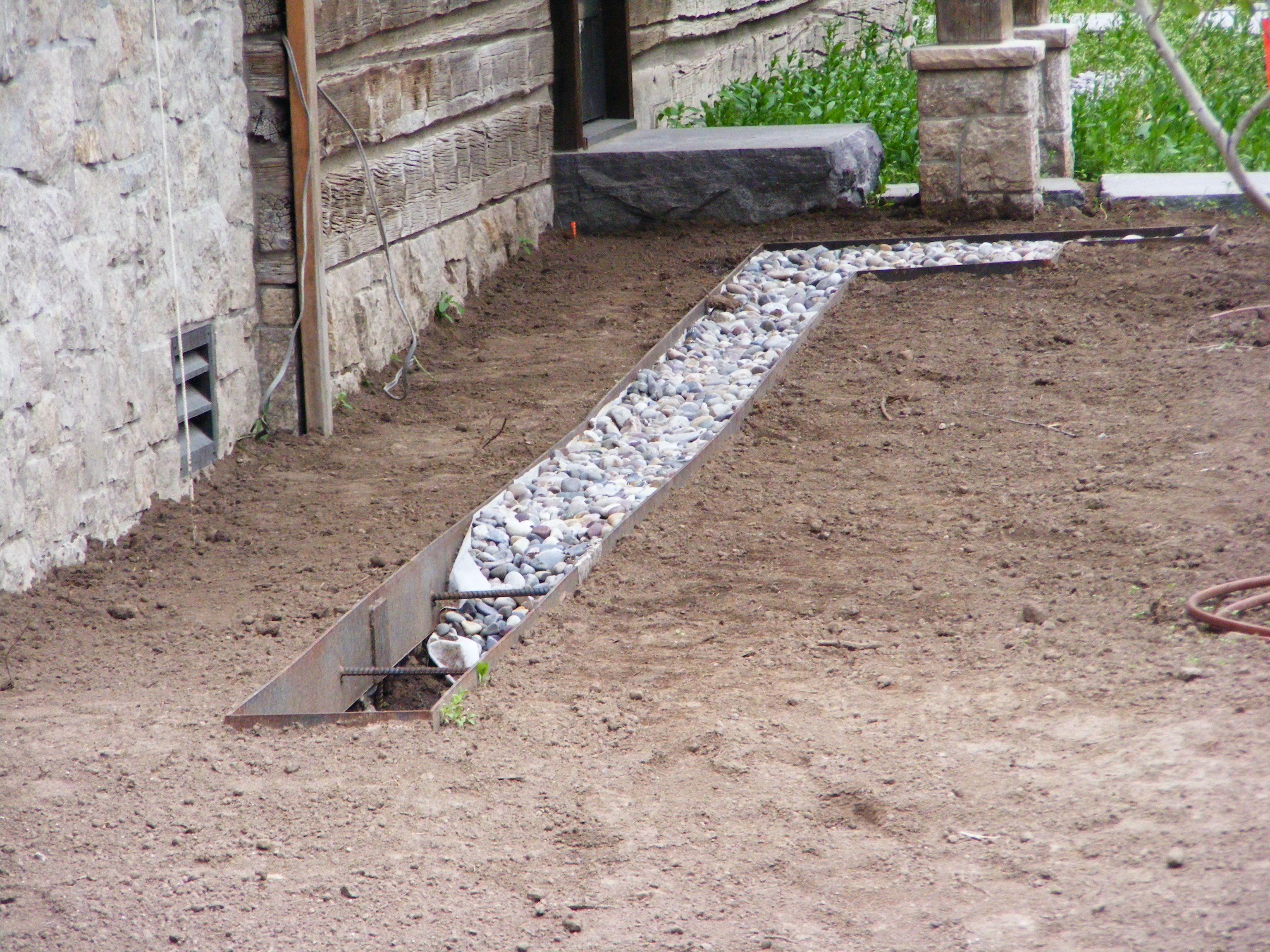 Drip line under the roof eaves  MD Landscaping, Driggs, Idaho  Daryl