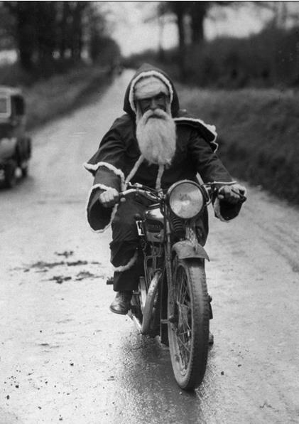 Vintage Santa Rides A Motorcycle