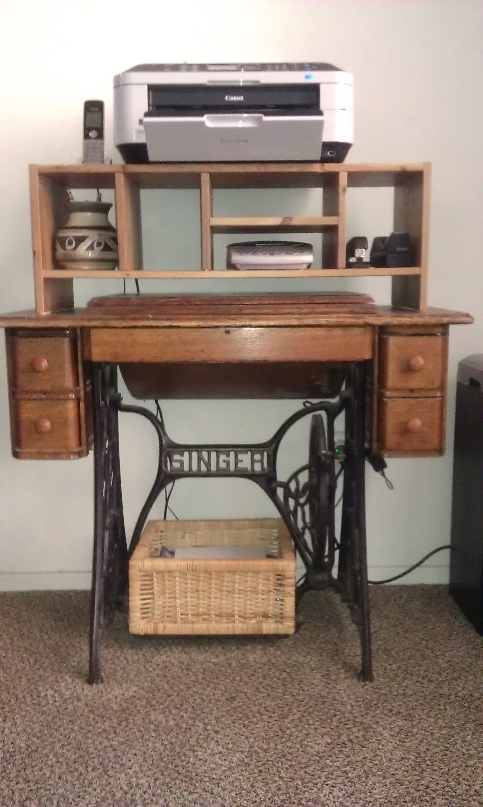 Old Singer sewing machine cabinet used as