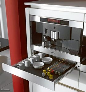 Miele built-in coffee system...no need to drive to Starbucks...you can do it all in your kitchen! The warming drawer keeps coffee cups & saucers ready to serve to not alter the taste of your espressos, lattes or teas.