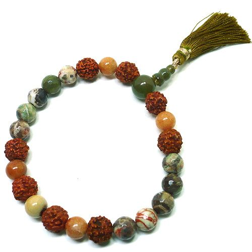 Warm autumn shades are displayed in this handmade stretch mala bracelet.  The main guru bead in this mala bracelet is carved green jasper which has an earthy olive green tone.  Faceted autumn jasper b