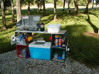 Camp kitchen with milk crates and can use crates to - Kitchen set up ideas ...