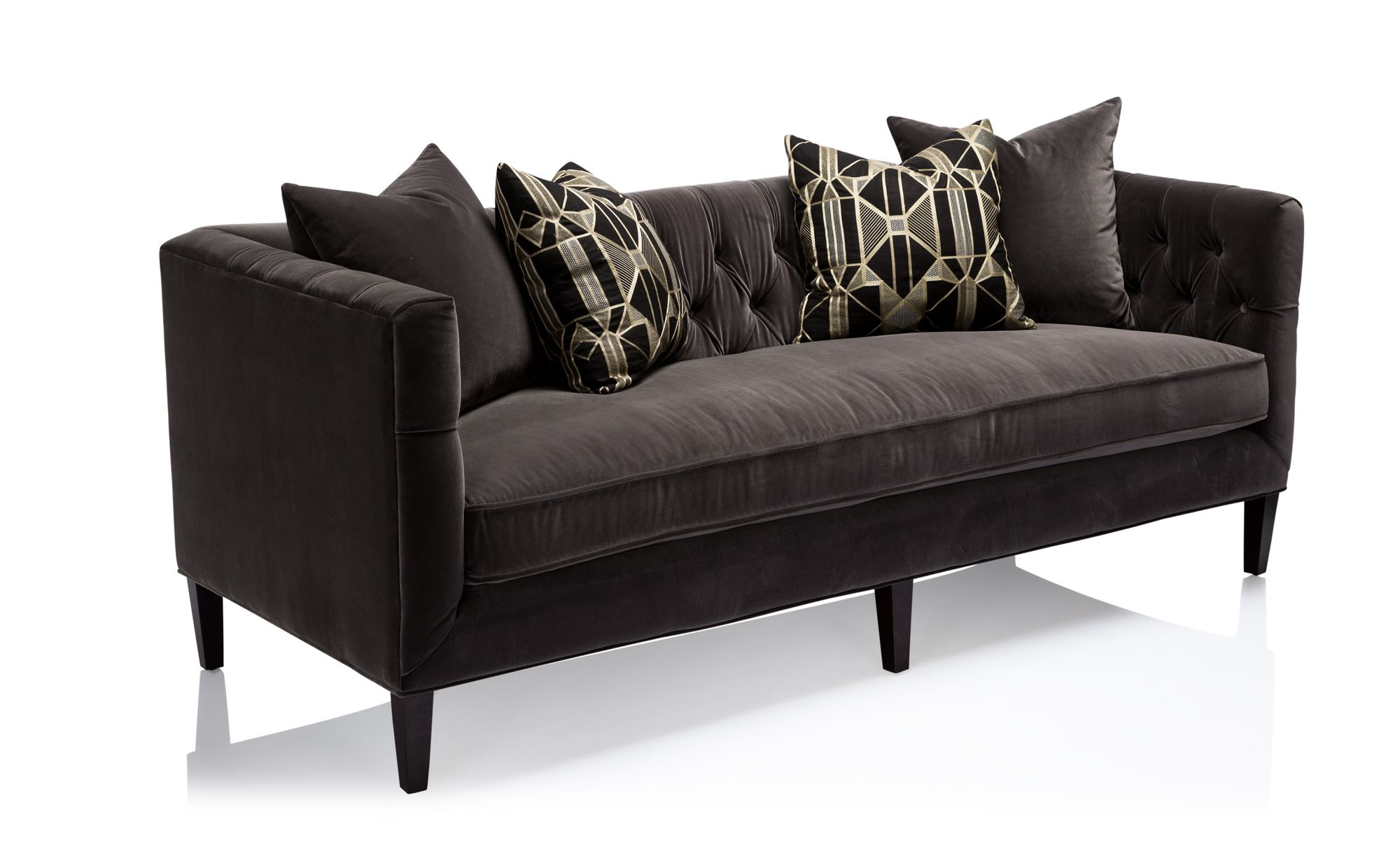 Available in a sofa or loveseat the Chamonix Tufted Sofa from