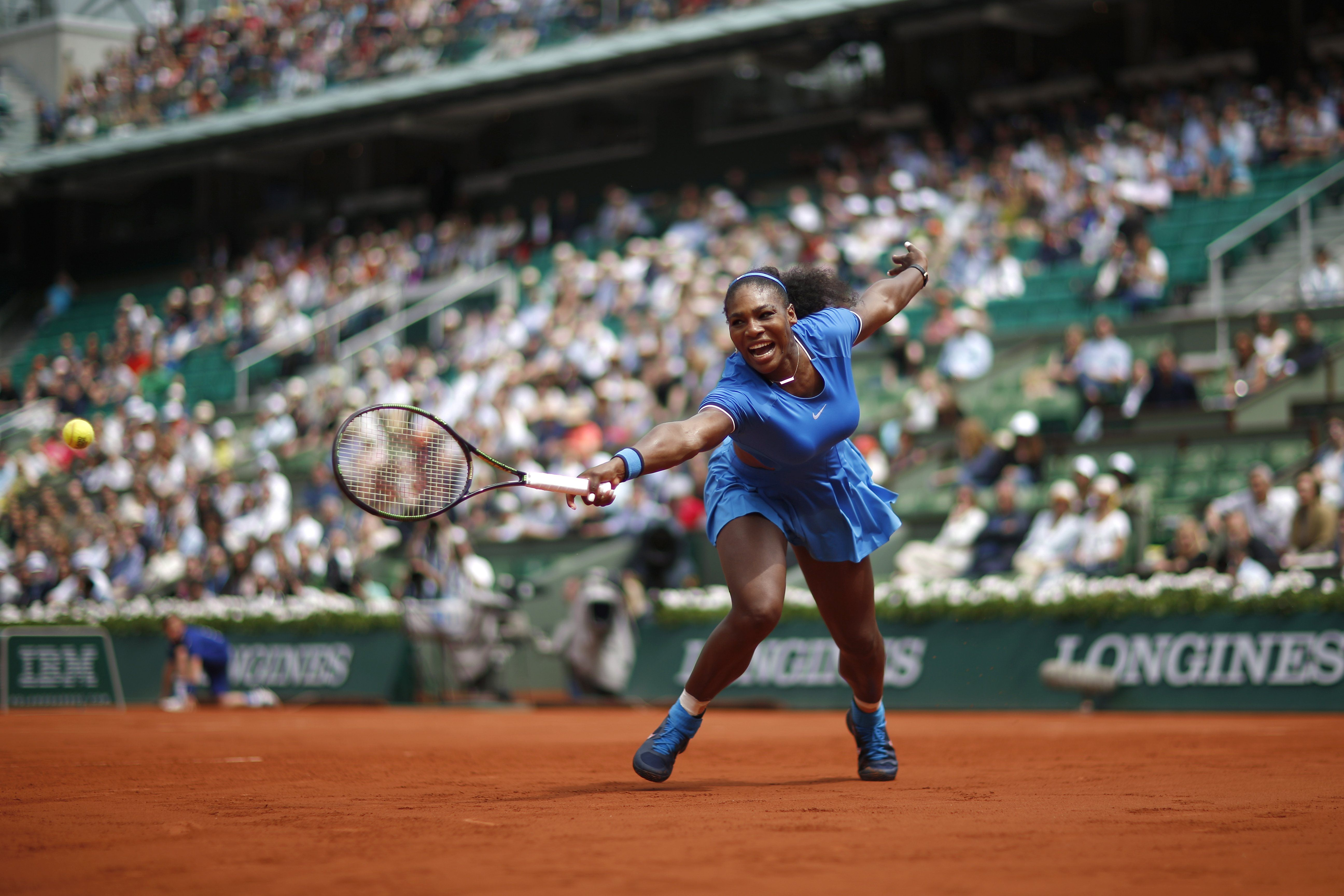 Serena Williams stretches for a return against France's Kristina Mladenovic in the third round of the French Open at Roland Garros. Williams progressed to the fourth round but her fitful victory over Mladenovic did not suggest that the defence of her title will be straightforward. Photograph: Christophe Ena/AP