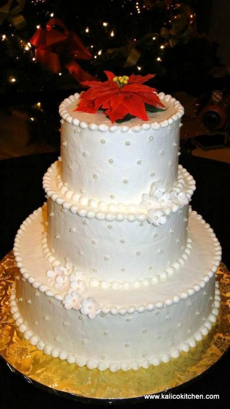 Wedding Cakes- 3 tier, buttercream, sugar flowers and pearls, poinsettia