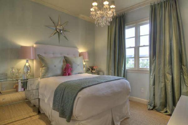 bedrooms - chandelier silver sunburst mirror tufted headboard soft blue walls mirrored nightstands silk blue green drapes silver lamps pink shades blue green silk pillows