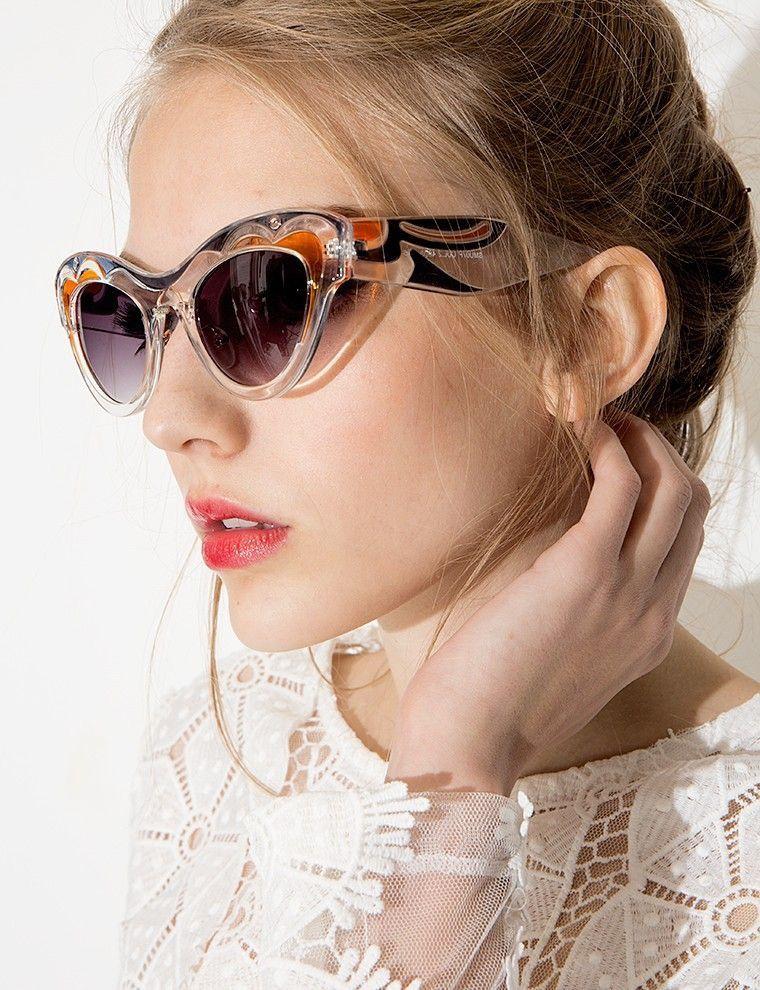 e5d8adb54f Miu Miu Transparent Cat Eye Sunglasses
