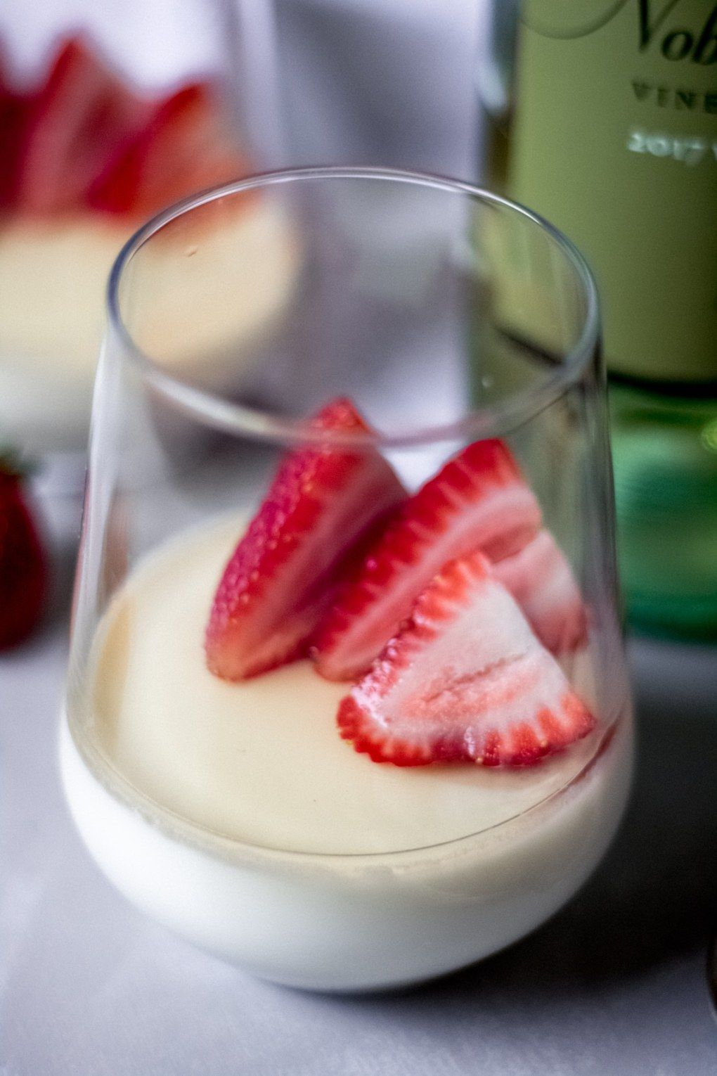 A Stemless Wine Glass With Vanilla Panna Cotta With White Wine Sauce And Fresh Strawberries Wine Desserts White Wine Sauce Dessert For Dinner