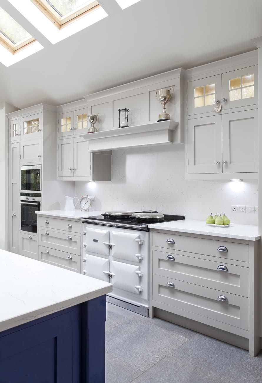 white kitchen with blue kitchen island and kitchen cabinets painted in farrow balls elephants breath - Hand Painted Kitchen Cabinets