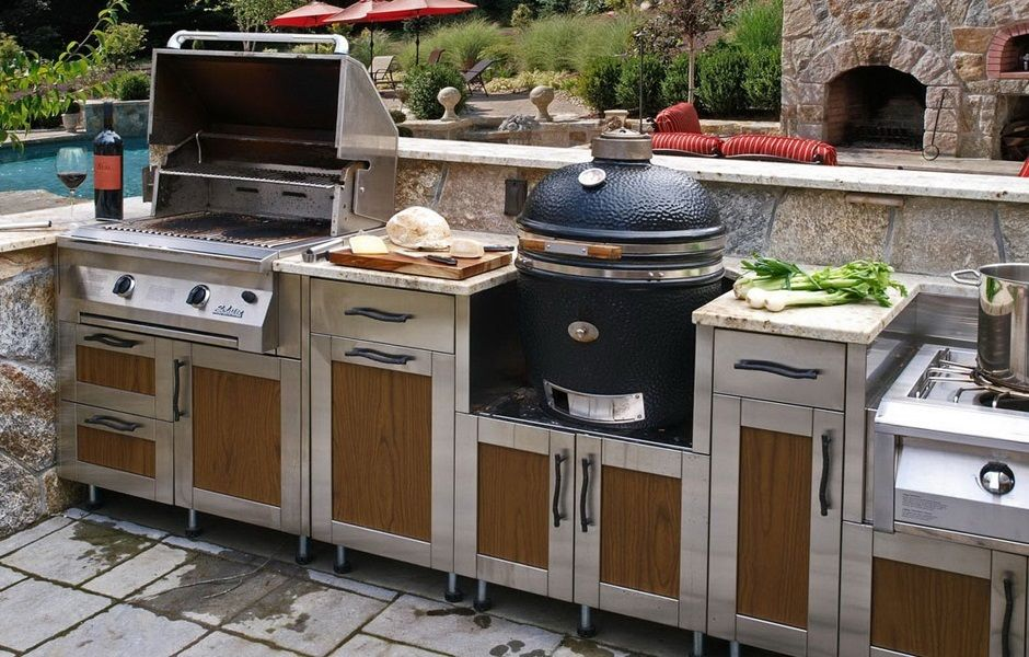 Danver Modular Outdoor Cabinets with Wood Panels. Also Features a Kamado Grill, Fireplace, and Power Burner