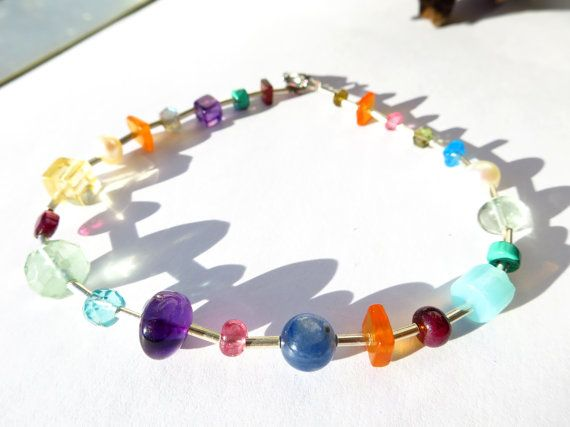 Tender Multi Gemstone Silver Bracelet with  Amethyst, garnet, fluorite, tourmaline, pearl, turquoise, carnelian, kyanite, Peru Opal The silver tubes are 2mm and 925 Sterling Silver The closure is a high-quality stainless steel carabiners Stainless steel does not discolour and I find the material now better than silver. The closure remains just as shiny and beautiful as the first day even after a long time. Stainless steel is particularly well suited for people who are prone to contact…