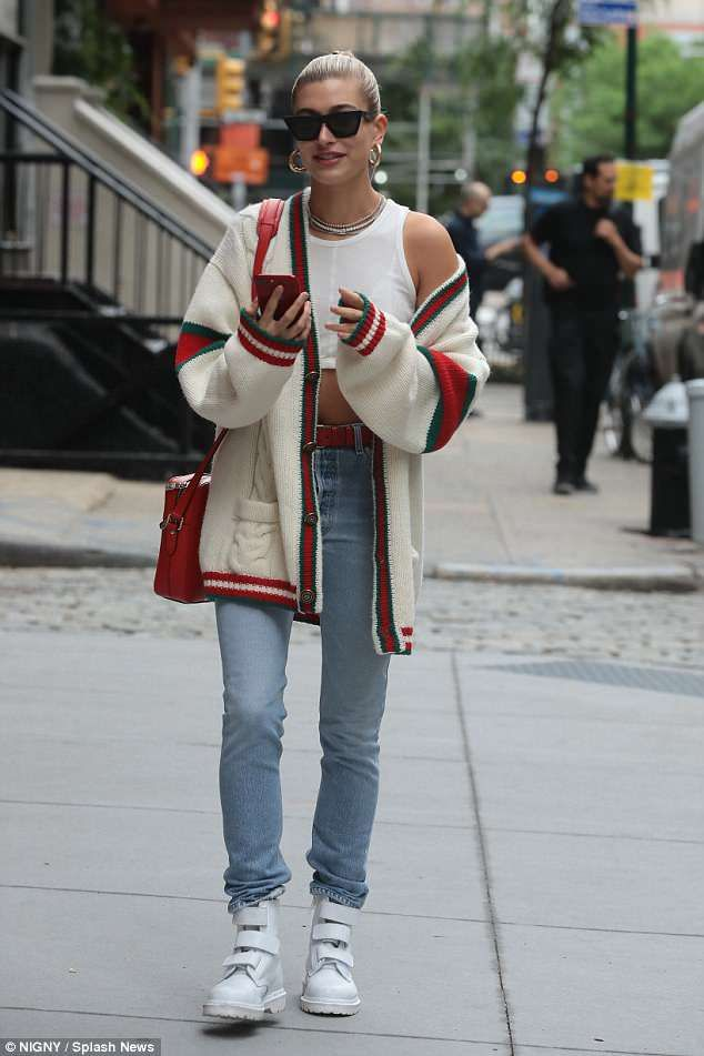 Hailey Baldwin bares her sculpted midriff in crop top and Gucci wrap
