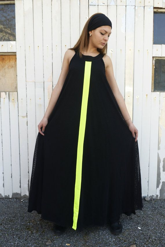 7054e3c9920 This unique design has two main features - the black mesh that is covering  the piece and the green-yellow neon line that goes all the way on the dress.