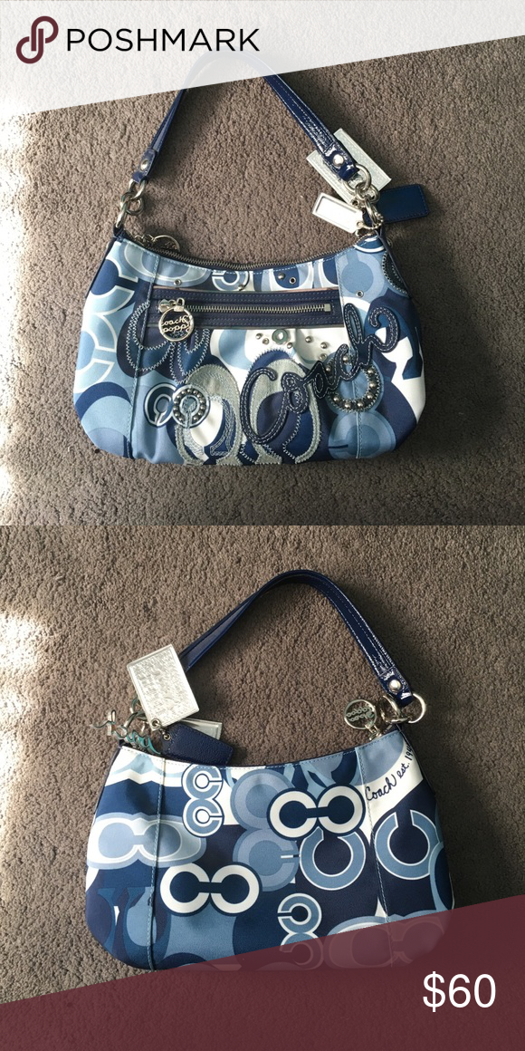 Blue and White coach bag I have not used this bag once since I got it so it is basically brand new. It does not have tags but it has legit never left my closet so it is in perfect condition. Coach Bags Shoulder Bags