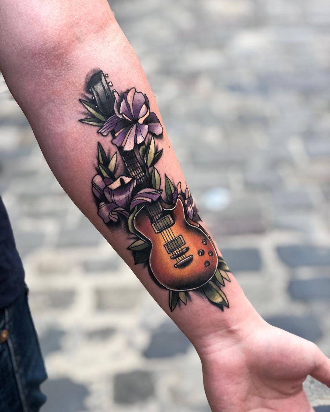 101 Awesome Guitar Tattoo Ideas You Need Tattoo Ideas Fairy Tattoo Designs Fairy Tattoo Designs Tat In 2020 Guitar Tattoo Design Guitar Tattoo Music Tattoo Designs