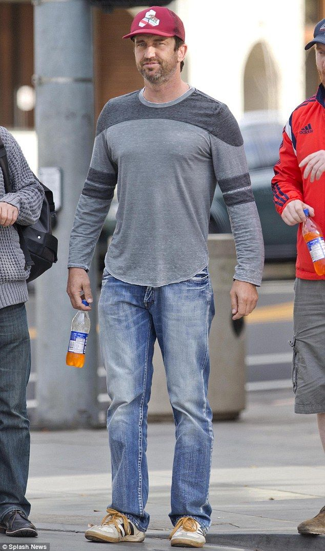 Dressed down star: Gerard was clad in jeans and a grey top with a pair of battered trainers and Irn Bru!