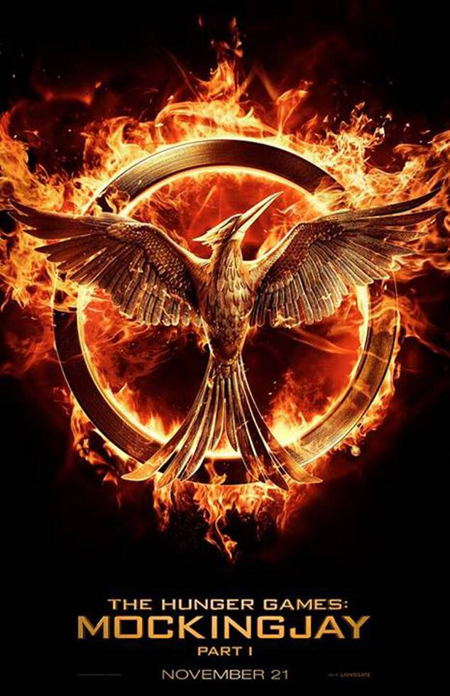 The Hunger Games Mockingjay Part 1 Poster Revealed Hunger Games Mockingjay Hunger Games Poster Hunger Games Movies
