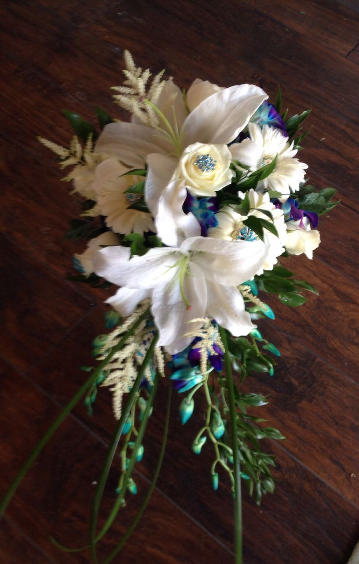 Image result for blue orchid white lily peach rose (With