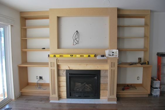 the living room a fireplace built in in 2019 wood working rh pinterest com Shelves Over Fireplace shelves above corner fireplace