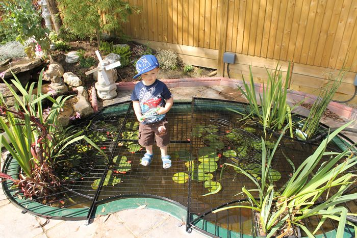 Elite pond covers bepoke artistic child pond safety for Garden pond grills
