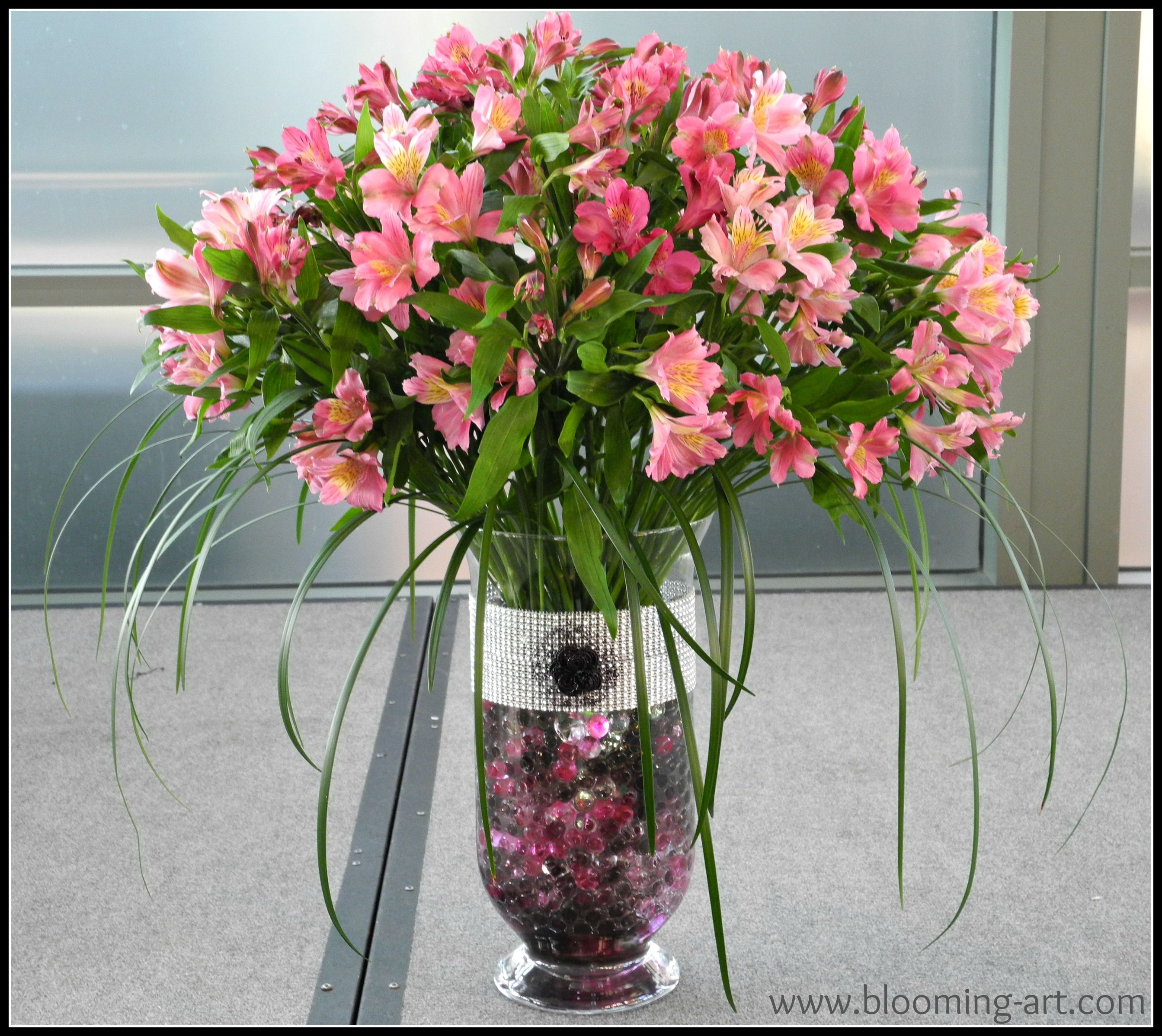 Big and dramatic alstroemeria arrangement in deco beads www welcome to blooming art floral design services of san diego where flowers and art come together for weddings parties and events of any size izmirmasajfo