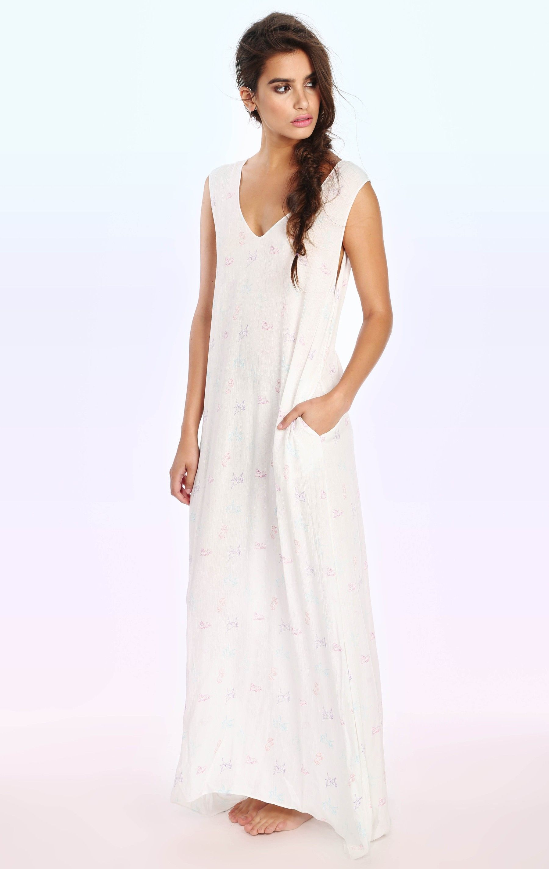Time to be a unicorn in our V-Neck maxi from our brand new Ready to Wear collection. Our incredibly soft and lightweight all-purpose maxi dress features a plunging back. Features a unicorn print throughout. Also comes in Solid Black.  Crinkle Rayon Model wears a size small