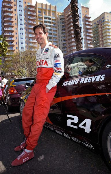 4/16/10 - Keanu Reeves leans up against his car as he gets ready to take the track for practice rounds for the 34th annual Toyota Pro/Celebrity Race in Long Beach. Photo by Steven Georges/Press-Telegram