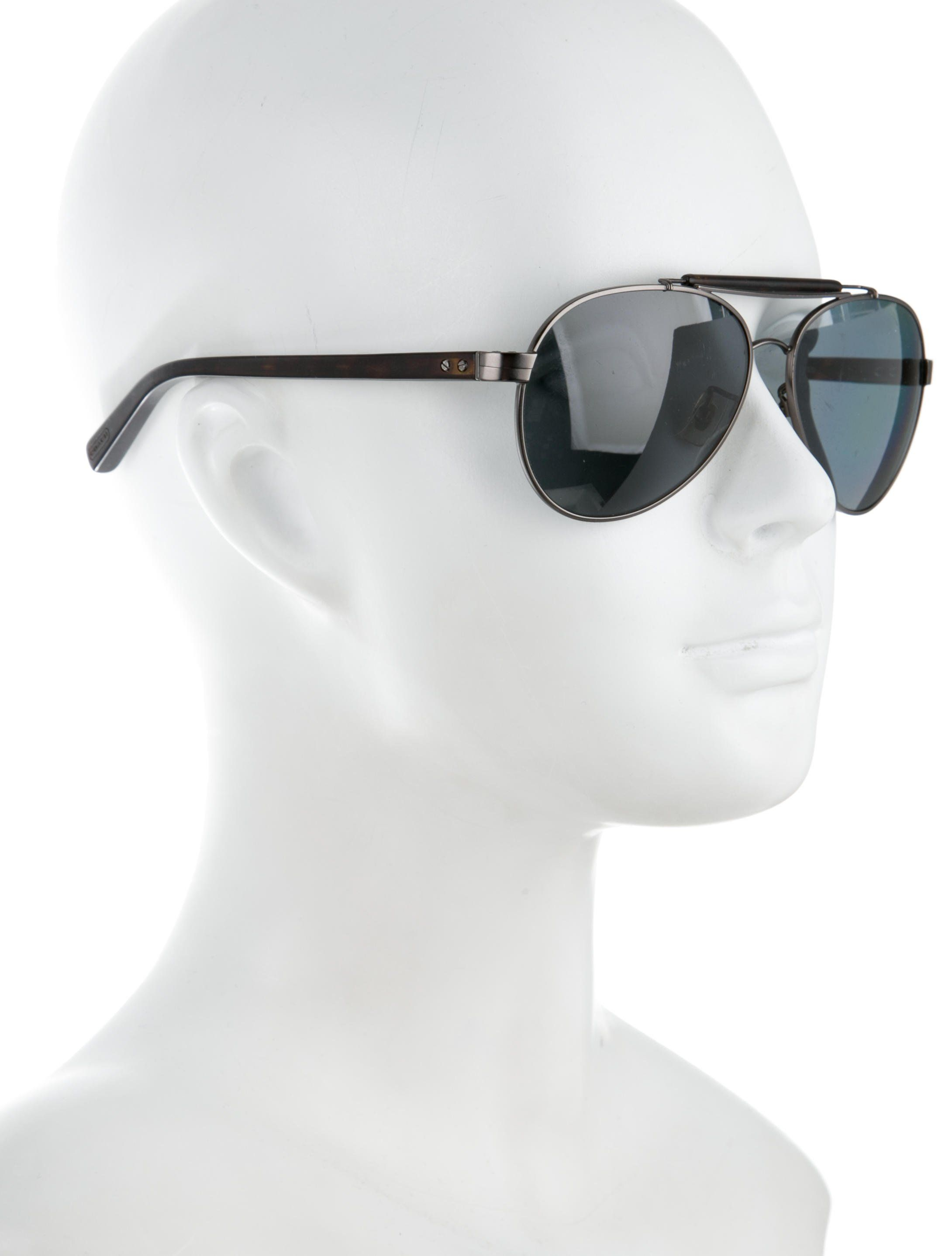 b6acfeed9690f Men s gunmetal Coach Harrison aviator sunglasses with polarized lenses and  logos at arms. Includes case.