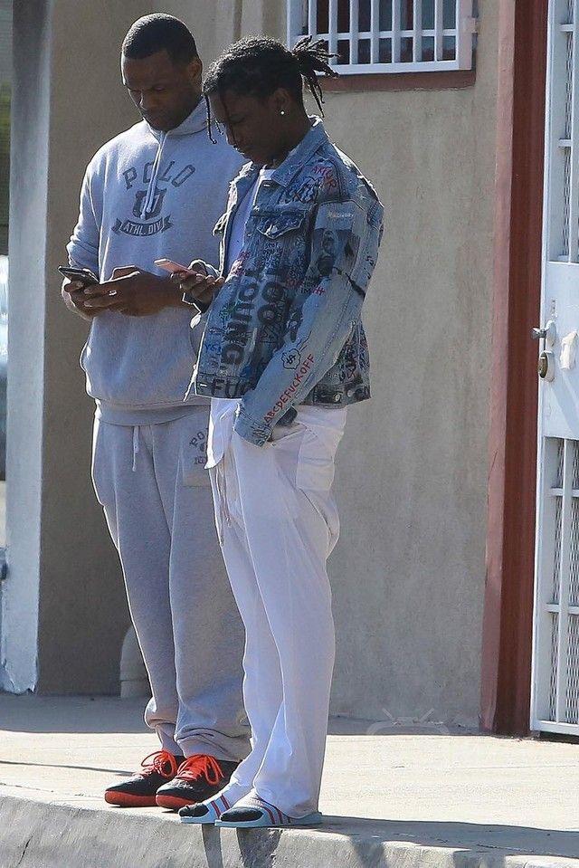 b1d84554 ASAP Rocky wearing Himumimdead Custom Miss Fortune 1988 Denim Jacket, Adidas  Adilette Slides