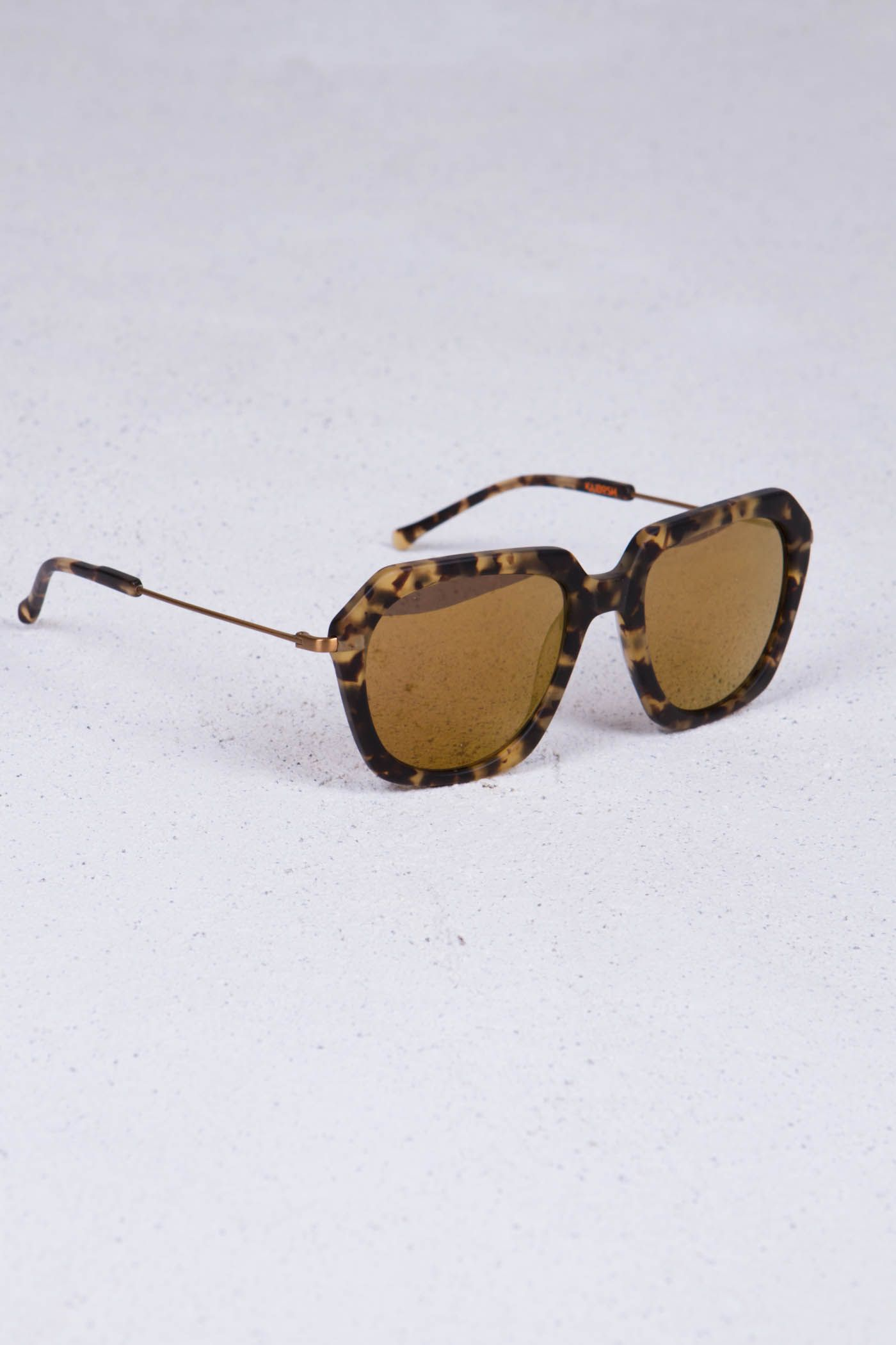 Charlie's Girl sunglasses by Norwegian brand Kaibosh︱Tortoise acetate frame︱Brown sun lens with gold mirror coating︱See more at www.grandpa.se