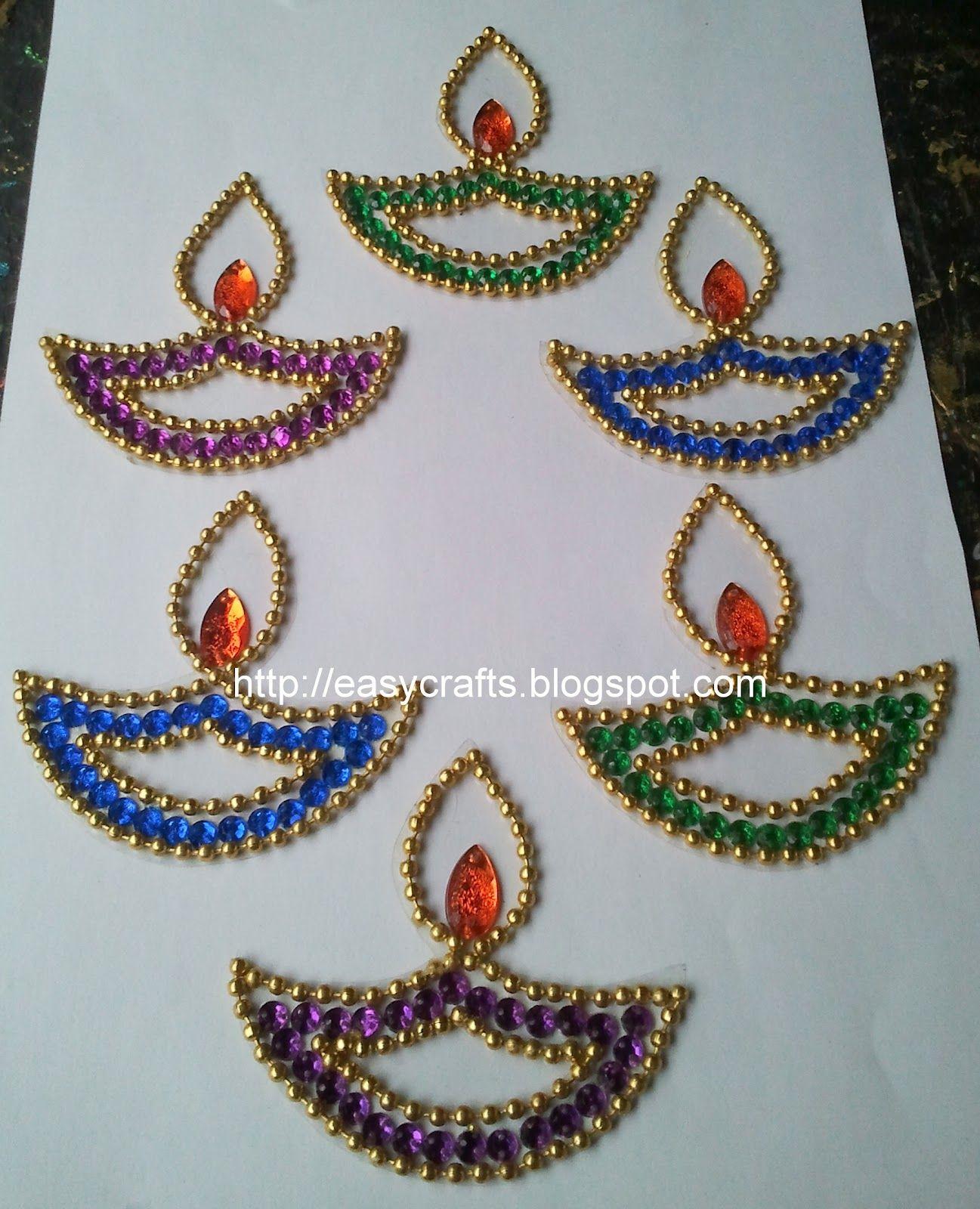 colourful diyas in kundan use it in your pooja room around bigger