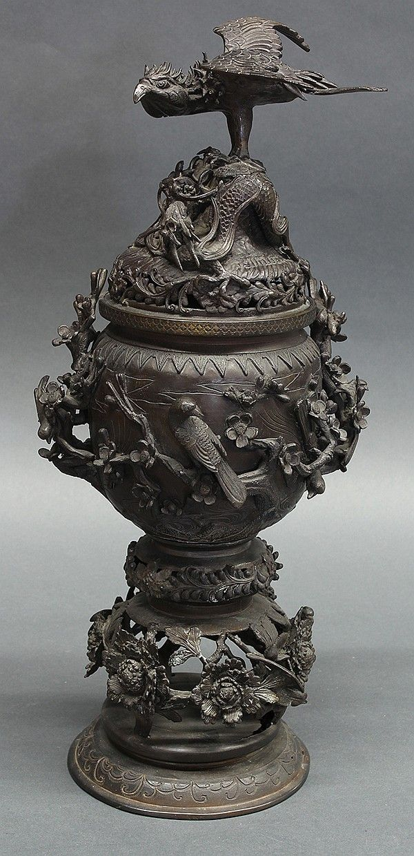 """Japanese bronze censer, late Edo/Meiji period, with a bird and dragon on the cover, central section of the body decorated with Japanese warblers perched on plum blossom branches, lower portion depicts pierced work with peonies, overall: 20""""h x 7""""dia"""