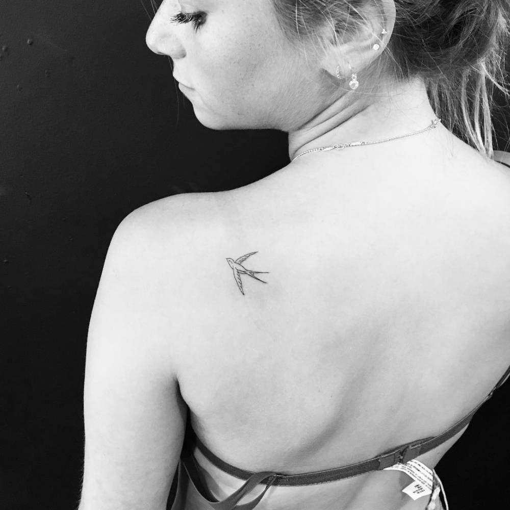 Minimalist Swallow Tattoo On The Left Shoulder Blade Small Shoulder Tattoos Blade Tattoo Swallow Tattoo