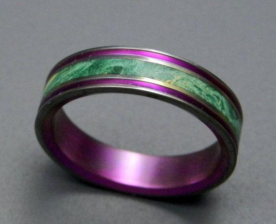 Titanium ring with wood inlay.