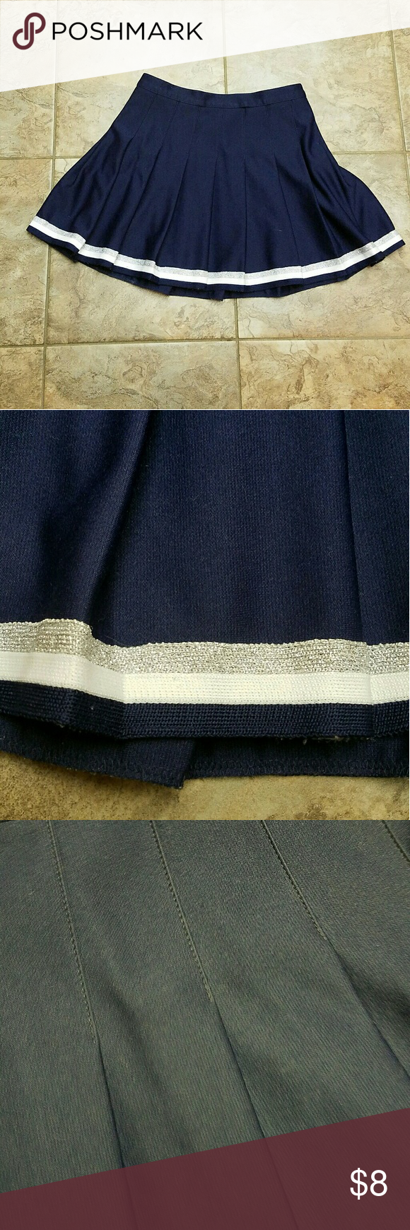 "Varsity Gal Skirt Super cute cheerleader skirt! Navy Blue with silver and white glitter trim. There's no size listed but it's definitely a small up to medium. The waist measures 14"" flat so probably around a size 28"" waist Urban Outfitters Skirts Mini"